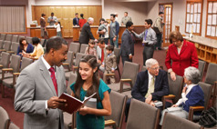 Jehovah's Witnesses and visitors spending time together at a Kingdom Hall