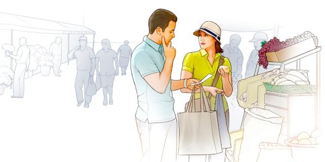 Una pareja compra con una lista de la compra