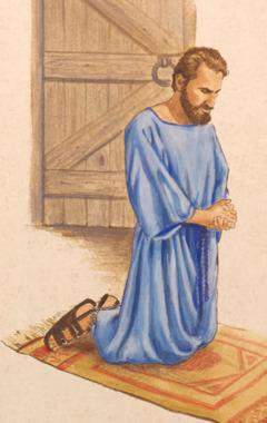 Behind a closed door, in a private room, a man kneels in prayer