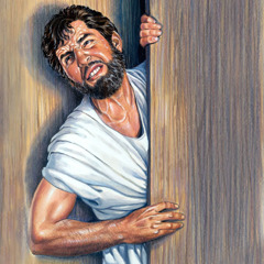 A man exerts himself vigorously to get in through a narrow door