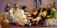 Jesus washes the feet of the apostles to teach them humility