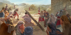 Jesus struggles to carry the heavy torture stake, and a soldier orders Simon of Cyrene to carry it for him