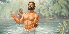 Jesus comes out of the water after being baptized by John the Baptist