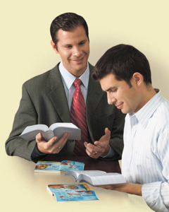 One of Jehovah's Witnesses studies the Bible with a man