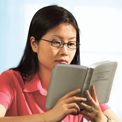 A woman studies the Bible