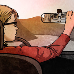 A young woman looks in a rearview mirror while driving a car