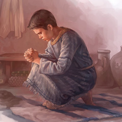 A boy kneels and prays