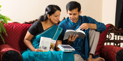 A husband and wife study the Bible together