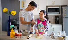 A husband and wife enjoy working together in the kitchen