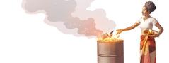 Nainen hävittää okkultismiin liittyviä esineitä polttamalla ne tulessa.