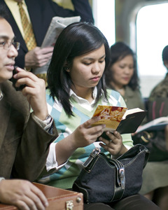 A woman reading the Bible on a train