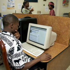 A young man viewing information on a computer screen