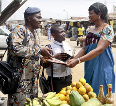 Two of Jehovah's Witnesses preaching in an African market