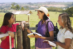Mariana and Caroline discussing the Bible with someone