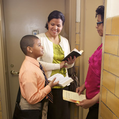 A young boy reading a Bible verse
