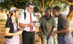 Katy and Eric preaching in Benin