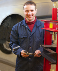 Ivars Vigulis helps repair cars at the branch office