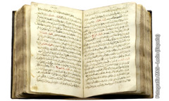An open copy of an Arabic translation of the Gospels