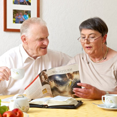 Roswitha and her husband studying a Bible-based publication together