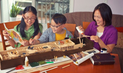 A family in the United States building a model of Noah's ark