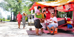 Jehovah's Witnesses preaching at a roadside fish market in Saipan
