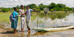 Jehovah's Witnesses sharing the good news with a fisherman along the Okavango River in Botswana