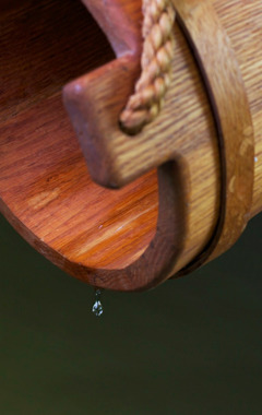 A drop of water falls from a bucket