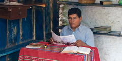 One of Jehovah's Witnesses studying a Watchtower magazine in an indigenous language