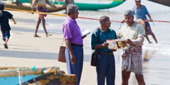 Jehovah's Witnesses share the Bible's message with a fisherman in Negombo on the west coast of Sri Lanka