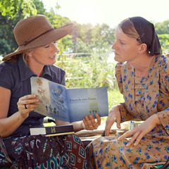 A sister preaches to a woman in Paraguay, using a publication in Low German