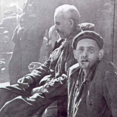 Starving men in a concentration camp