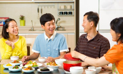 A family enjoys spending time together by sharing a meal at home