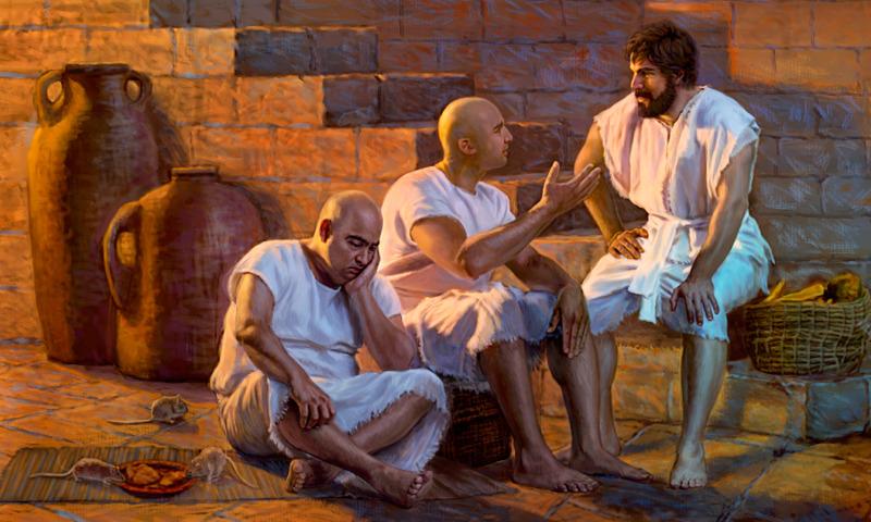 Joseph est assis avec d'autres prisonniers