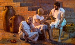 Joseph sitting with fellow prisoners