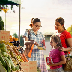 One of Jehovah's Witnesses sharing the good news at a fruit stand