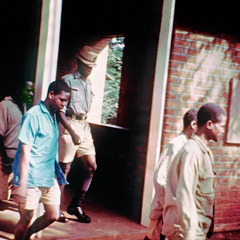 Jehovah's Witnesses being led away during a trial