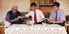 Two of Jehovah's Witnesses in Armenia conduct a Bible study with a man