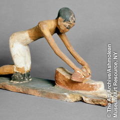 Egyptian artifact of a person grinding on a hand mill