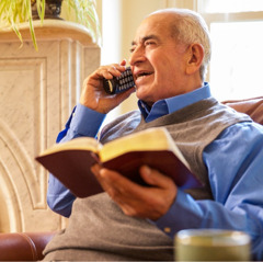 An older brother uses the telephone to share a scriptural point