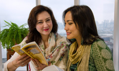Mina Hung Godenzi conducts a Bible study with a woman
