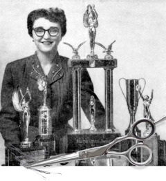 Melita Jaracz stands beside trophies she received for hairdressing