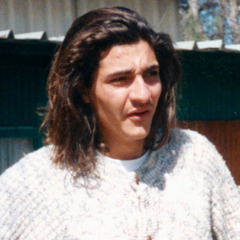 Alain Broggio as a young man with shoulder-length hair