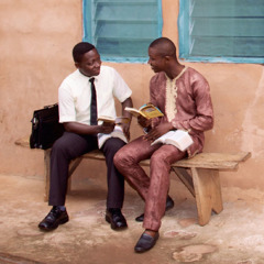 One of Jehovah's Witnesses conducts a Bible study with a man