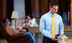 A young man prepares to go to a meeting while his family relaxes