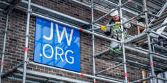 JW.ORG sign displayed prominently on the Wijnegem Kingdom Hall in Belgium