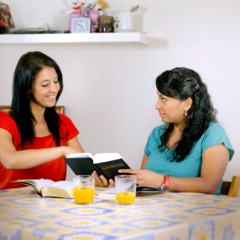 Raquel shares a scripture with a woman