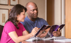 Husband and wife wey dey study Bible together