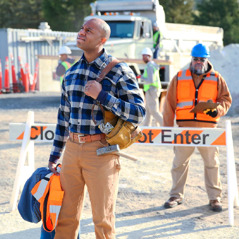 A brother walks away from a work site after losing his job