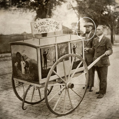 Hans Hölterhoff uses a cart to advertise The Golden Age