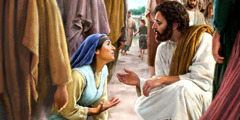 A woman falls down before Jesus, and he bends down to talk to her